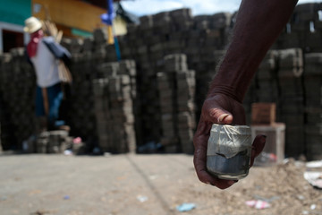 A man carries a homemade bomb in front of a barricade in the indigenous community of Monimbo in Masaya