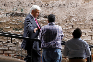 Mexico's President-elect Andres Manuel Lopez Obrador leaves after a meeting with the new members the Senate and lawmakers of his party MORENA in Mexico City