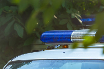 Blue siren flasher on the police car. Flash light and siren on the emergency car. Police signal.