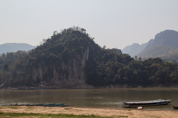 Laos: the lower Pak Ou cave near Luang Prabang with the the mekong river