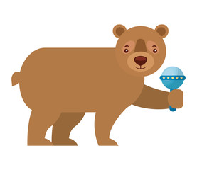 brown grizzly bear holding rattle toy