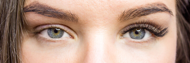 Eyelash Extension Procedure. Before and after. Woman Eyes with Long false Eyelashes. Close up macro shot - Beauty and fashion concept