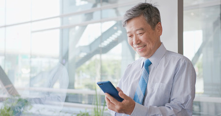 old businessman use phone