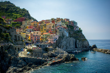 The Town of Manarola builded on the Cliff in a Summer Day