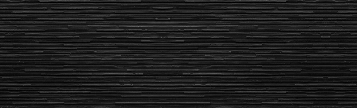 Panorama of black modern stone wall background and pattern