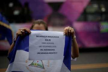 Nicaraguans living in Costa Rica demonstrate in support of Nicaraguans protesting against the government of Daniel Ortega, in front of the Nicaragua Embassy in San Jose, Costa Rica