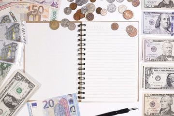 close up of banknote and coin with notebook for background