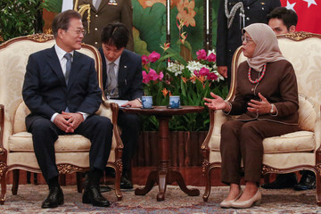South KoreaÕs President Moon Jae-in meets with SingaporeÕs President Halimah Yacob during a visit at the Istana in Singapore