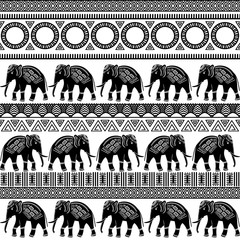 African tribal seamless pattern with animals and geometric ornaments. Abstract monochrome background. Textile design. Vector illustration.