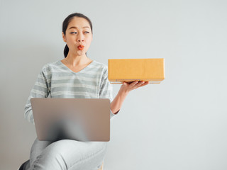 Concept of woman happy with her online business sale.