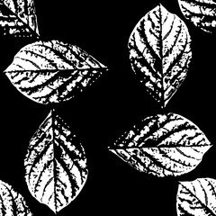 Prints of leaves of trees. Seamless pattern.