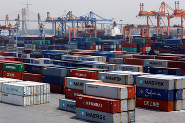 Shipping containers are seen at a port in Hai Phong city
