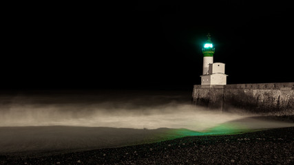 green light house in a dark night