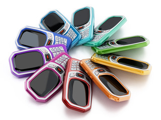 Old style multi colored mobile phones with keypad. 3D illustration