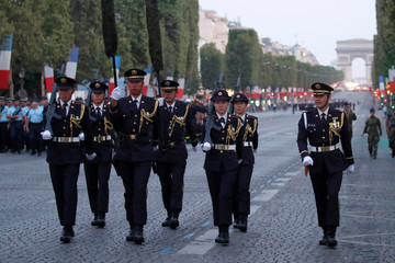 Japanese 32nd Infantry Regiment soldiers attend a rehearsal of the Bastille day parade on the Champs-Elysees avenue in Paris