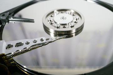 Hard disk discs. Open hdd hard disk. Data recovery from damaged media. Disk head above the plates.