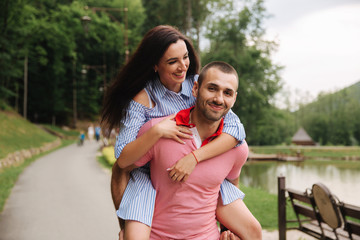 Beautiful couple walking in the park near the lake