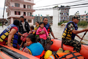 Nepalese Army rescue locals on a dinghy in a flooded neighborhood after incessant rainfall in Bhaktapur