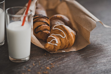 A bag of croissants and glasses of milk for Breakfast 1338.