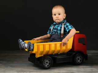 Boy with his toy car