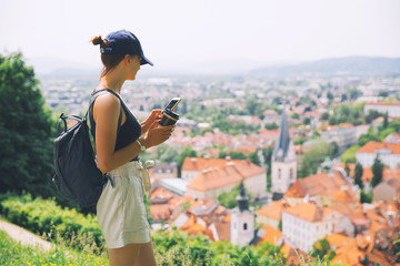 Beautiful woman on background of Ljubljana City, Slovenia. Travel Europe