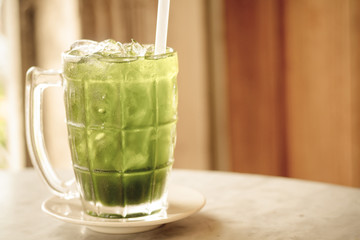 Green Cordial Syrup / Green Cordial Syrup In Clear Glass On Table.