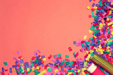 Festive party decor and confetti on pink background
