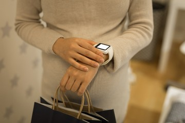 Pregnant woman using smartwatch