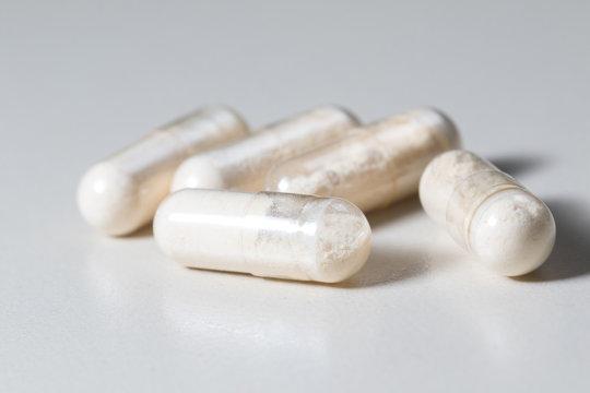 Bunch of  Antibiotics capsules on white background