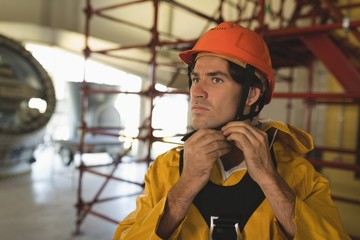 Male worker wearing hard hat at solar station
