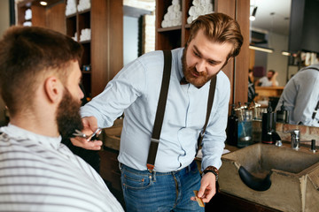 Barber Cutting Man Beard In Barber Shop. Beard Hair Cut