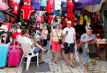 Russian tourists are seen shopping at the old medina in Sousse