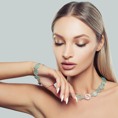 Nice Blonde Hair Woman Wearing Jewelry Necklace and Bracelet, Fashion Beauty Portrait. Glamorous Makeup and Accessories