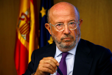 Former chairman of Banco Popular Saracho looks on in Parliament in Madrid