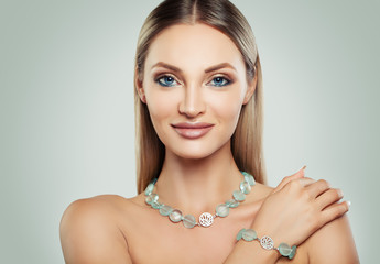 Smiling Woman Fashion Model with Makeup and Jewelry. Silver Necklace and Bracelet with Semiprecious Stones