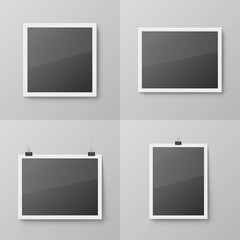 Realistic blank photo frames set. Mockup picture frame hanging on binder clips. Isolated vector framework with shadow on the wall. Black empty place for presentation. Interior decoration 3d element