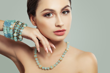 Closeup Portrait of Young Woman with Makeup and Blue Jewellery