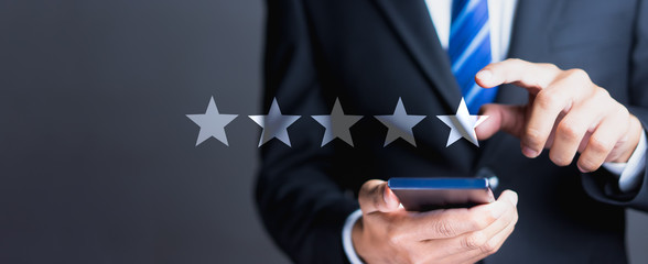 Businessman pointing five star to increase rating, Customer feedback and experience concept.
