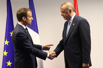 France's President Emmanuel Macron shakes hands with Turkey's President Recep Tayyip Erdogan ahead of a bilateral meeting on the sidelines of the NATO summit in Brussels