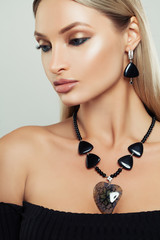 Closeup Fashion Beauty Portrait of Glamorous Woman with Makeup, Jewelry Necklace and Earrings