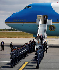 U.S. President Donald Trump and First Lady Melania Trump arrive aboard Air Force One, for their first official visit to Britain, at Stansted Airport