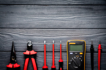Electric tools on black wooden backdrop
