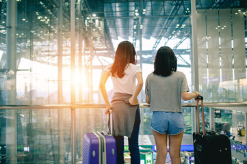 Two young woman in the airport,