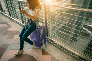 Women are using their smartphones to Flight Checking at airports.airports and technology concept