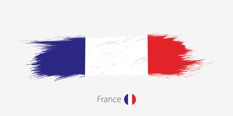 Flag of France, grunge abstract brush stroke on gray background.