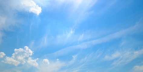 Lightclouds in the blue sky. Wide photo.