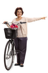 Elderly woman with a bicycle pointing
