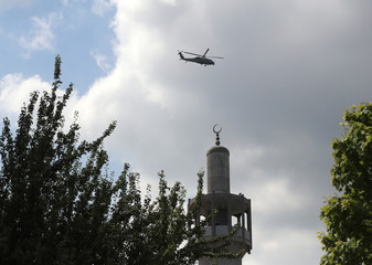 Marine One, carrying U.S. President Donald Trump and First Lady Melania Trump on their first official visit to Britain, flies in over London Central Mosque in Regent's Park on its way to the U.S. ambassador's residence, Winfield House, in London