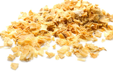 Dried sliced potatoes in small pieces isolated on white