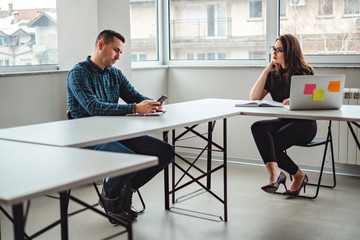 Woman looking at her male colleague in the office